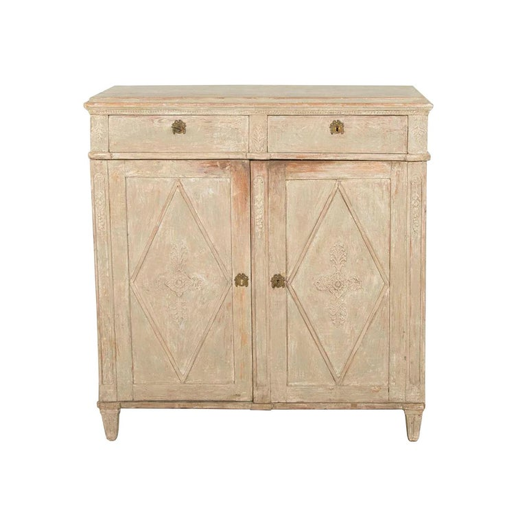 A fine late Gustavian sideboard made in the beginning of the 19th century. Small repairs on the original plaster decorations. Original paint inside. Later made feet. This piece has been repainted.
