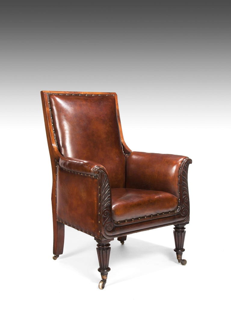 A fine late Regency / William IV neoclassical designed mahogany library armchair upholstered in leather.