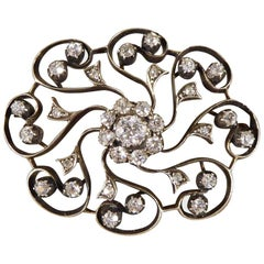 Late Victorian 1.10 Carat Total Diamond Flower Cluster Brooch in Gold and Silver