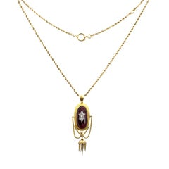 Late Victorian 18 Carat Gold Garnet and Diamond Pendant