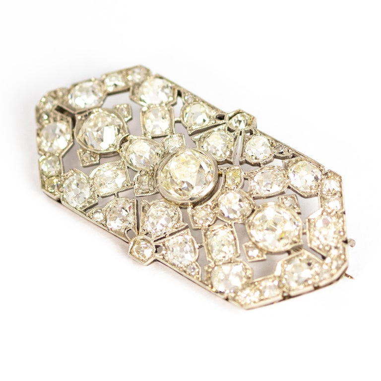 This exquisite late Victorian brooch was crafted in London, England circa 1900. Fully set with stunning white old mine cut diamonds. The central stone measures an impressive 1.70 carats and is flanked by two 1.0 carat diamonds. All the diamonds have