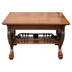 Late Victorian Aesthetic Period Carved Walnut Library Table with Claw Feet