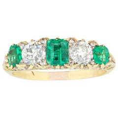 Late Victorian Emerald and Diamond Carved Half Hoop Ring