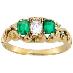 Late Victorian Emerald and Diamond Three-Stone Ring