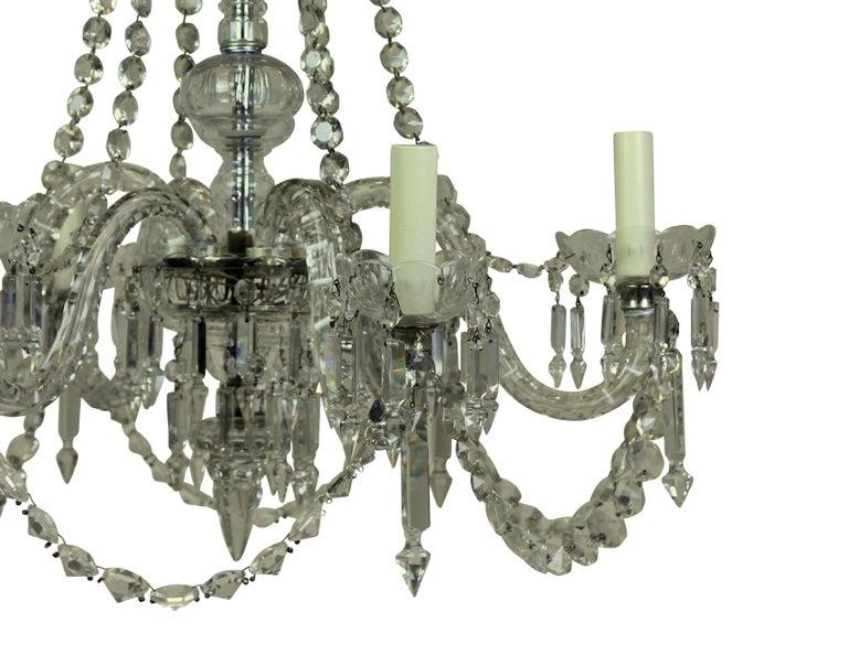 An English cut-glass six-arm chandelier of good quality.