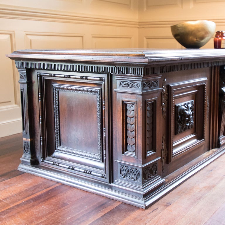 This is a very exciting late Victorian find. Believed to be English walnut with hand carved female pilaster and green man detailing. Quite an exceptional piece with a variety of uses in the modern home. It would make an incredible side cabinet, with