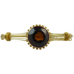 Late Victorian Gold Bangle with Cairngorm Quartz, 15 Carat Gold
