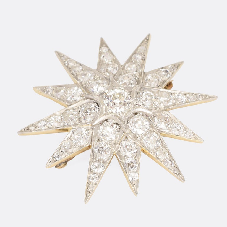 A stunning late Victorian diamond star brooch dating from the turn of the (20th) Century. It's set with 4.75 carats of icy old mine cut diamonds, mounted in beautifully worked platinum settings with fine millegrain detailing to the edges. The
