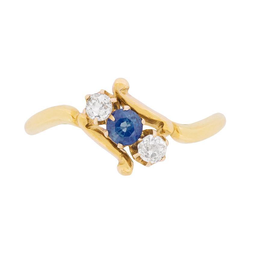 Late Victorian Three-Stone Sapphire and Diamond Twist Ring, circa 1900s