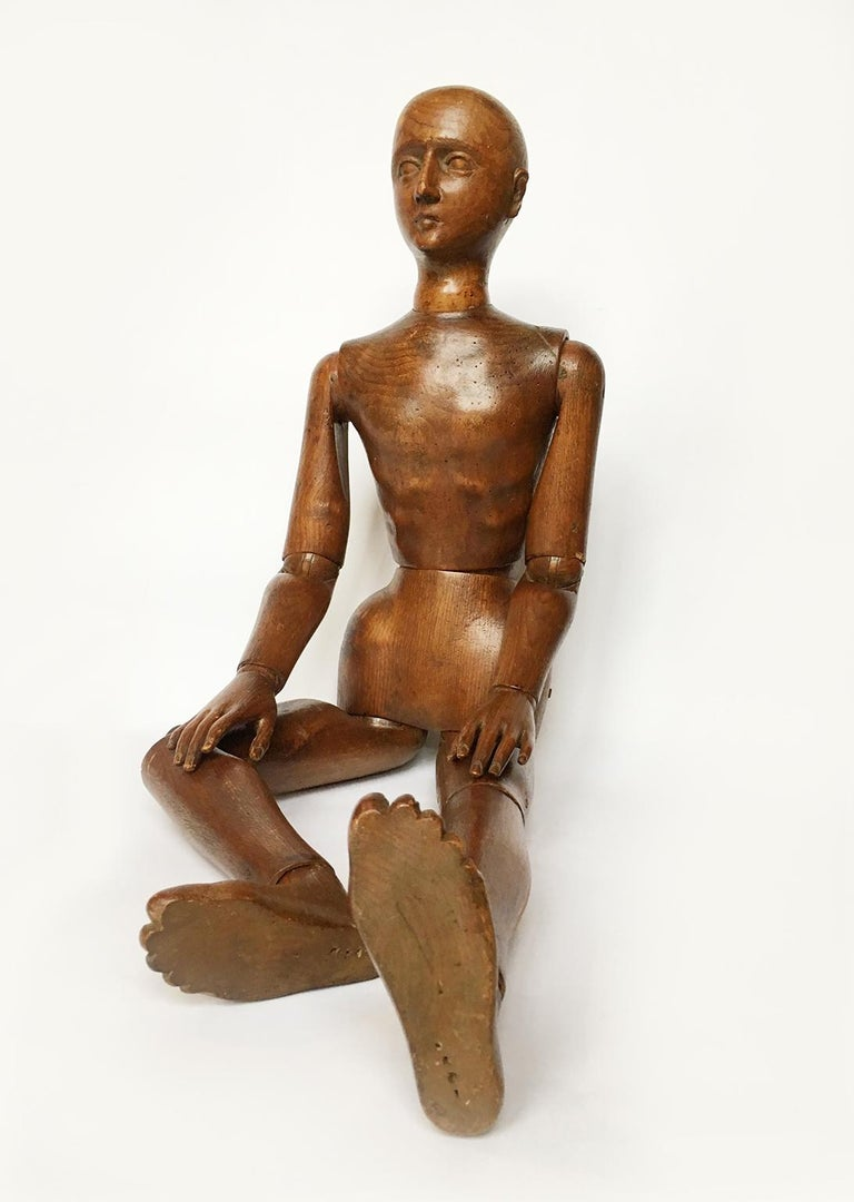 Atelier mannequin graven and carved stone pine wood Italy, late 19th century Measures: H 102 cm x 25 cm x 14 cm H 40.15 in x 9.84 in x 5.51 in Weight: circa kg 4 State of conservation: good. Small gaps in the ears and behind the right knee. A