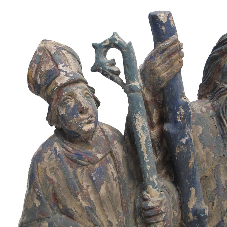 Spanish Colonial carving of three saint figures, having remnants of original old paint, Mexico, early to mid-19th century.