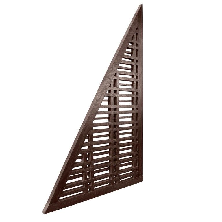A triangular lattice window panel from the Oak Park Country Club, circa 1914.