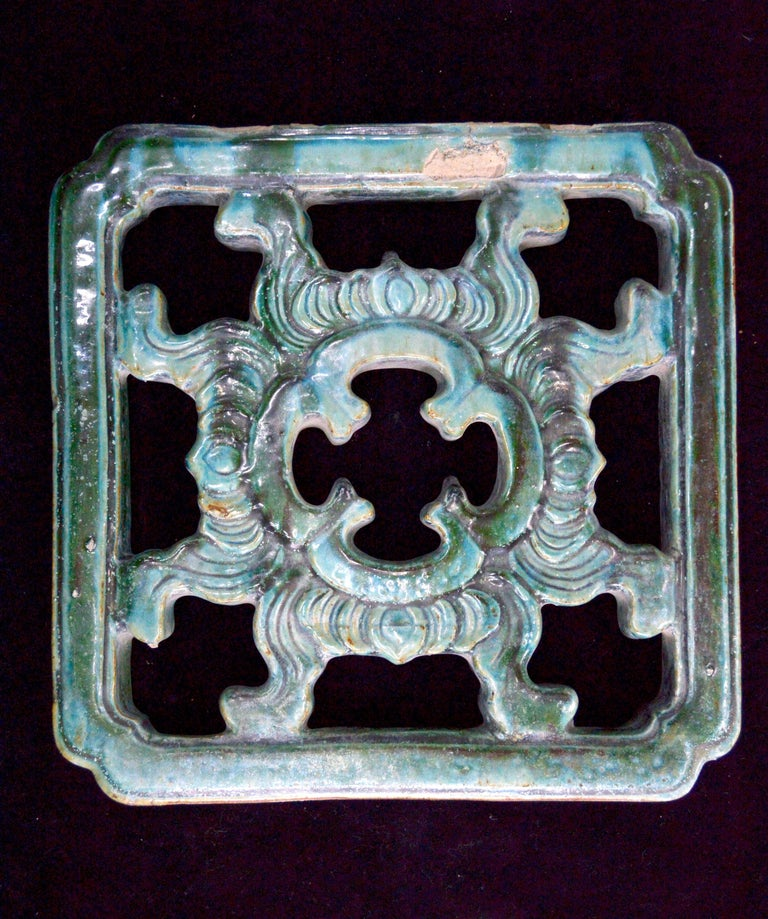 Beautiful Ming dynasty latticework from the Forbidden City. Beautiful glazed teal colored terracotta with a geometric pattern and a flowerlike mandala form on the centre. Great condition with minor chips. Excellent patina.  Ming dynasty,