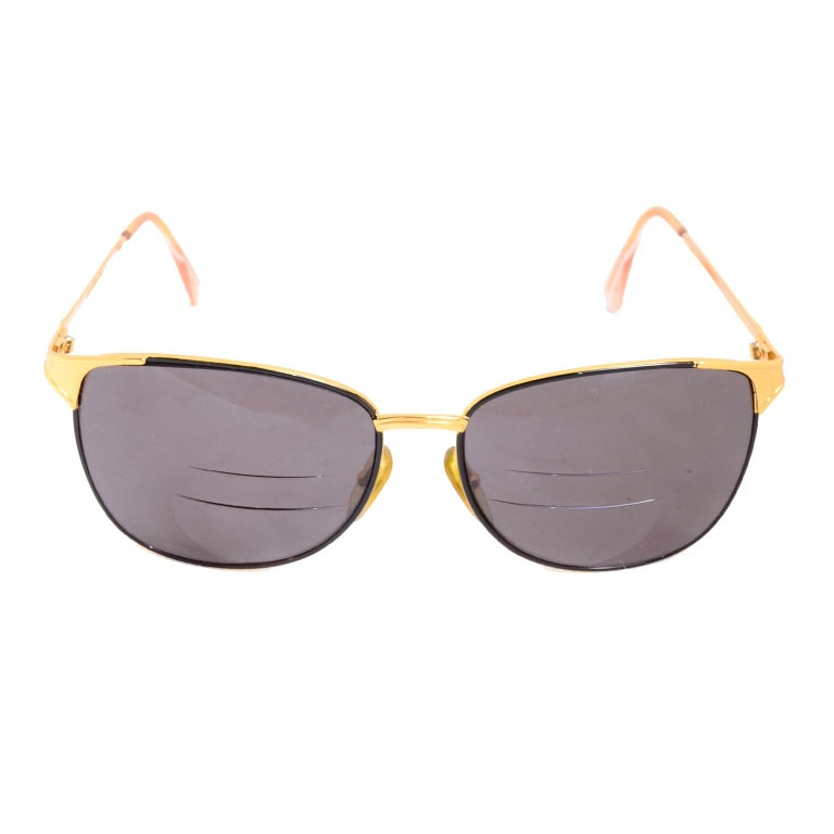 These are lovely Laura Biagiotti gold rim sunglasses.  The lenses are prescription so you would need to have them changed to fit your personal need - either with regular sunglass lenses or your own prescription.  Marked:  T 601/6 PO5 Made in Italy