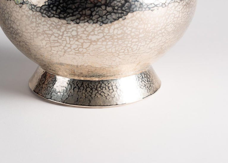 One of a series of beautiful, lobed vases created by American designer Laura Kirar in collaboration with 5th-generation artisans in Michoacan, Mexico. To create these remarkable pieces, raw copper is heated and hand hammered into shape before adding