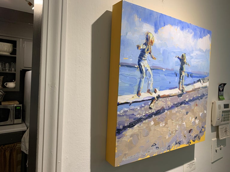'Walking the Log' is a small Impressionist oil on canvas beach painting with figures created by American artist Laura L. Shubert in 2020. Featuring a palette made of beige, blue, brown, blue grey and white tones, the painting draws us in with its