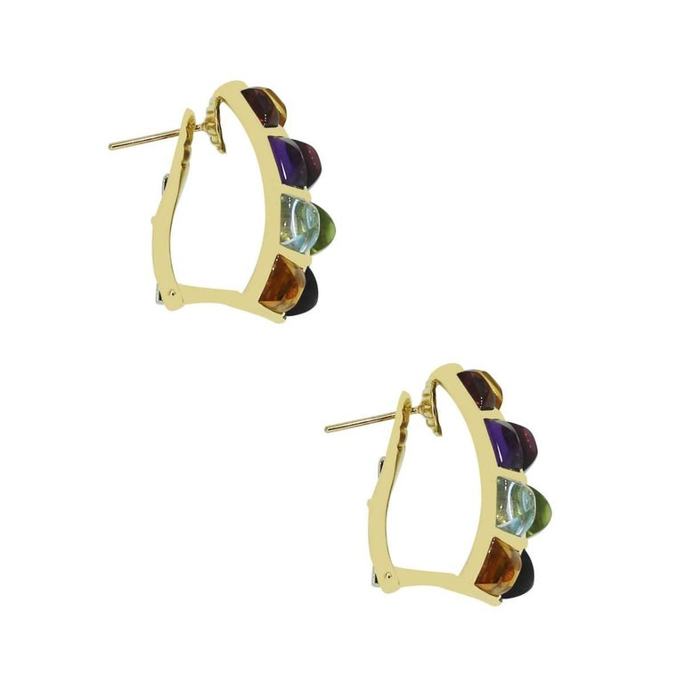 Material: 18k yellow gold Gemstone Details: Amethyst, citrine, pink and blue tourmaline gemstones each measuring approximately 6.02mm x 5.75mm Fastening: Omega backs Measurements: 0.80″ x 0.75″ x 1″ Item Weight: 20.9g (13.4dwt) SKU: G7206