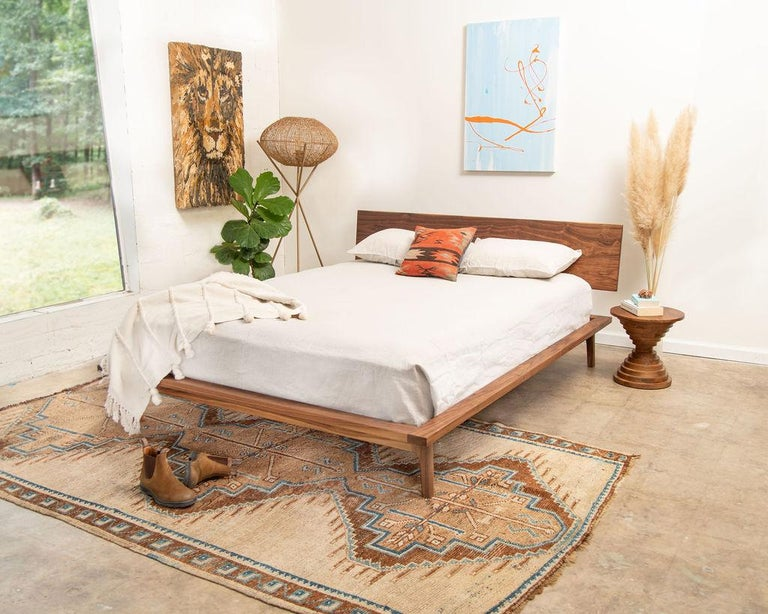 Inspired by Danish simplicity and organic design, the laurel bed features sculpted legs, modest angles, and sturdy joinery. The bed is constructed from North American sustainable walnut with each leg joint hand-filed and shaped to flow seamlessly