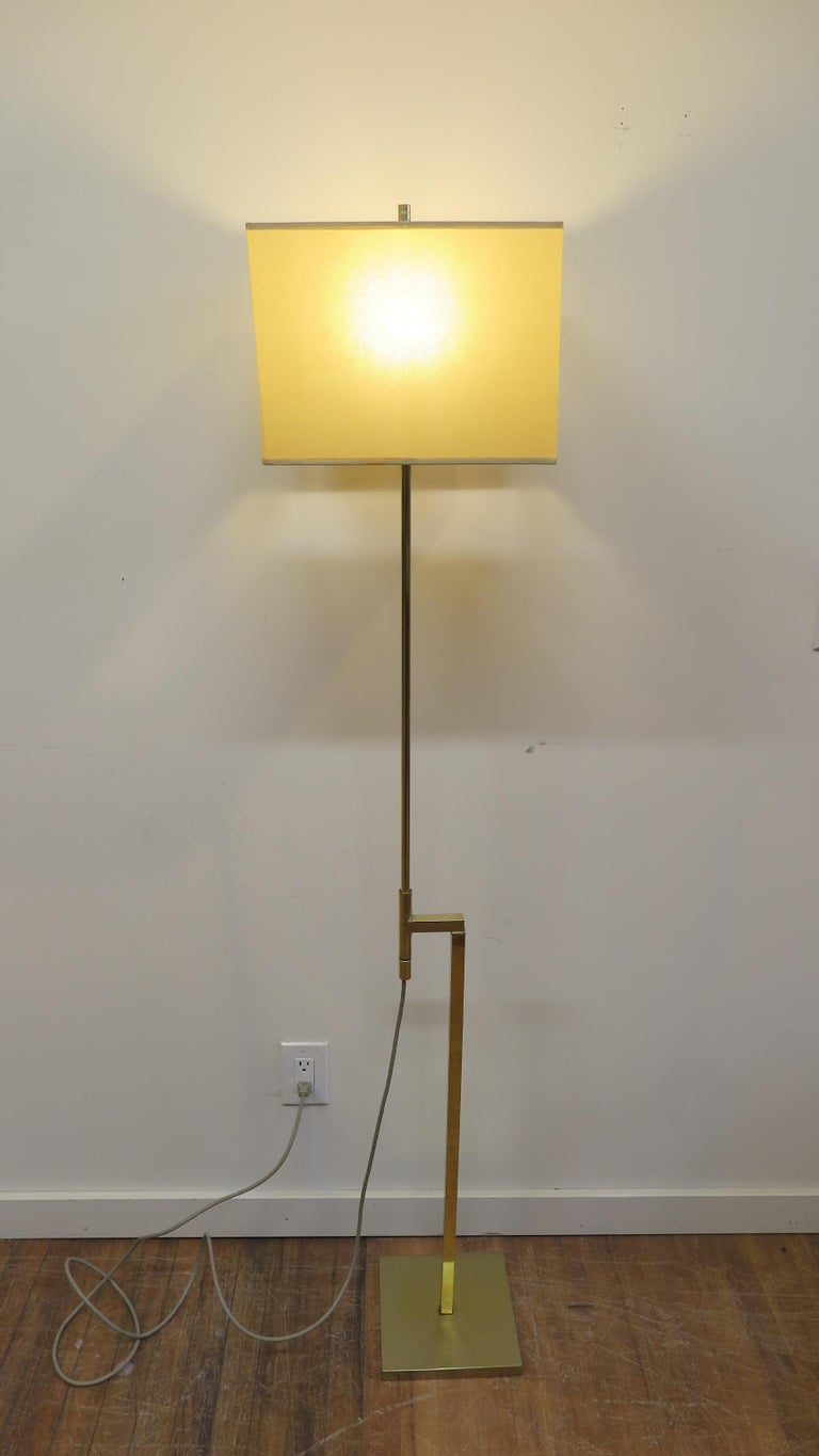 Laurel brass floor lamp adjustable height with built in dimmer. Height can be from 43 to 65 inches. Note solid brass socket with built in dimmer switch LED capable. Height is adjusted by sliding the pole up or down. This lamp is in very good