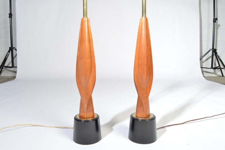 A beautiful pair of sculpted walnut table lamps by Laurel Lamp Co., circa 1960
