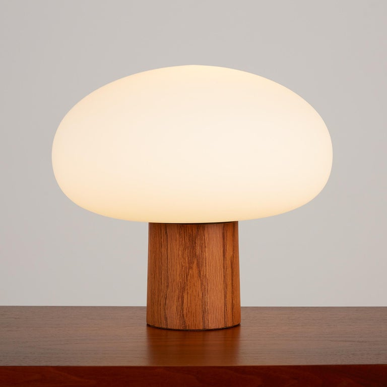 Mushroom table lamp by Laurel Lamp Company, c.1960s, USA. This lamp features a round frosted blown glass bulb and Walnut cylindrical base with the original brass rotary on/off switch. It's a beautiful piece to add mood lighting to any library or