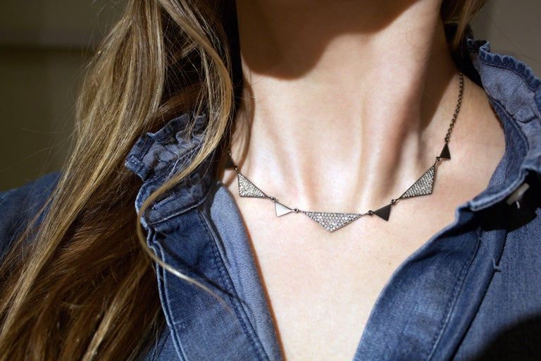 Trinity Necklace handmade by jewelry designer Lauren Harper in matte-finished oxidized sterling silver with 1.92 total carats of round brilliant-cut white diamonds on an oxidized sterling silver extension chain that can be worn at any length between
