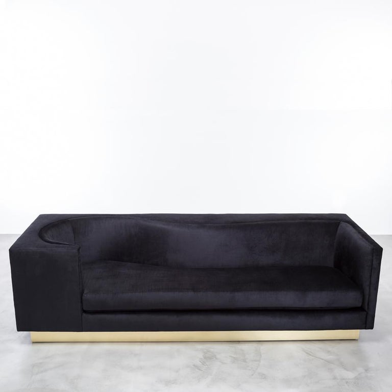 The Laurent sofa is a sexy study of contained curves in architecture. This asymmetrical sofa revels its carved inner curves as you make your way around the minimal modern rectangular frame. Fully custom and made to order in California. As shown in