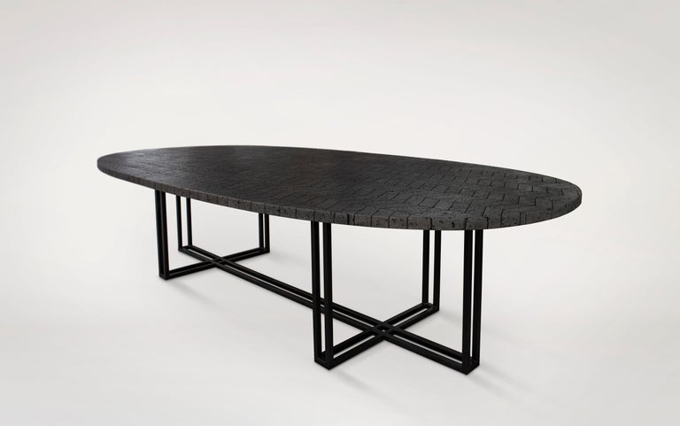The vast volcanic stone stretches across a 330 x 150 cm oval top featuring a composition of hand-cut, polished and mounted pieces. The metal base provides character and strength. The large-format Lava table is ideal for adding its energetic feel to