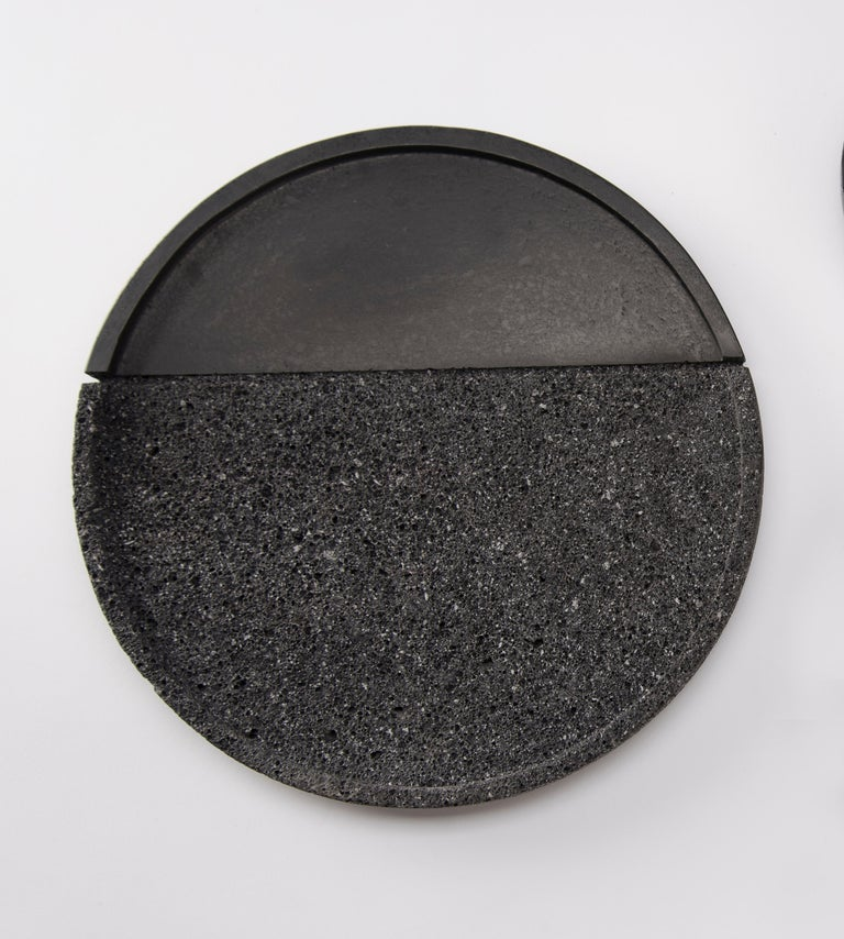 Volcanic rock is a witness to the power of nature: hand-polished by craftsmen with a millenary tradition, its unruly nature is transformed into a sensible and human object. With their dual texture, the collection of Lava plates is as much an homage