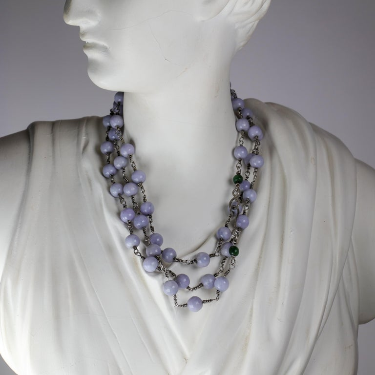 If you love lavender jade —and I mean really, really, really love lavender jade— this extravagant necklace just may be made for you.  It is composed of fifty-five 10 mm natural and untreated hand-carved medium-tone lavender jade beads and two small
