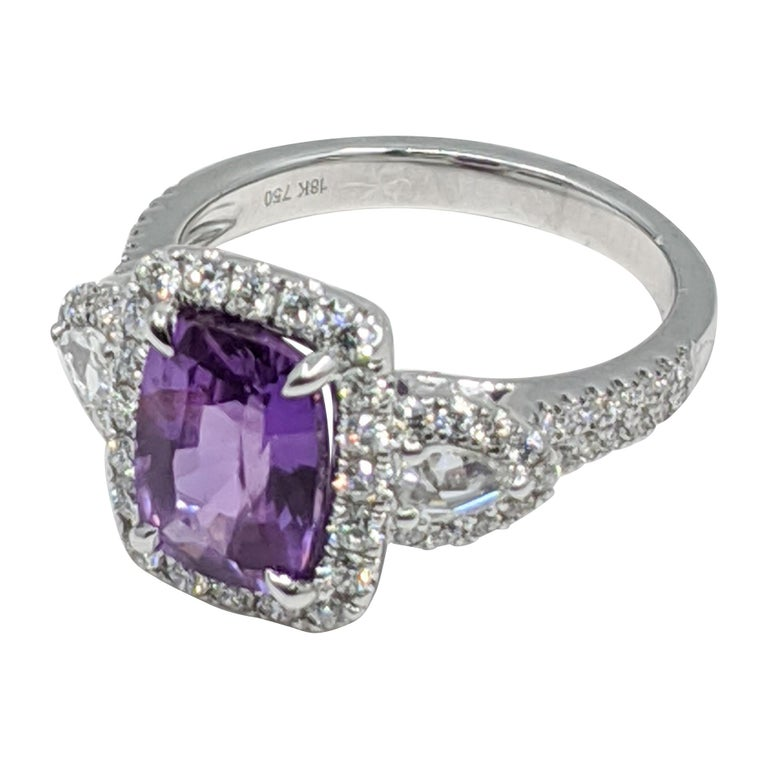 Lavender Sapphire (No heat) ring, with white diamond stones. 18k Gold