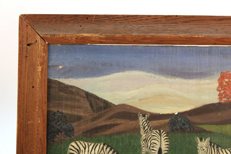 American Folk Art painting featuring a trio of zebras at a small pond, made by Lawrence Lebduska (1894-1966). One zebra is drinking from the water and two others are standing nearby. Lebduska is known for having executed murals for New York interior