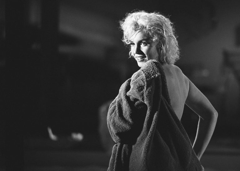 Lawrence Schiller Portrait Photograph - Marilyn Monroe Photograph Putting on a Robe, 24/75