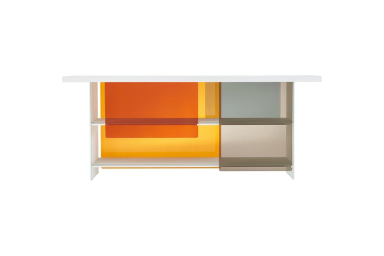 Layers Bookshelves is shown here in the matte extralight lacquered glass, and in large size of the two tables. Bookshelves in white matt extralight lacquered glass, 8+8 mm. thick laminated and glued. The shelves are partially obscured by sliding