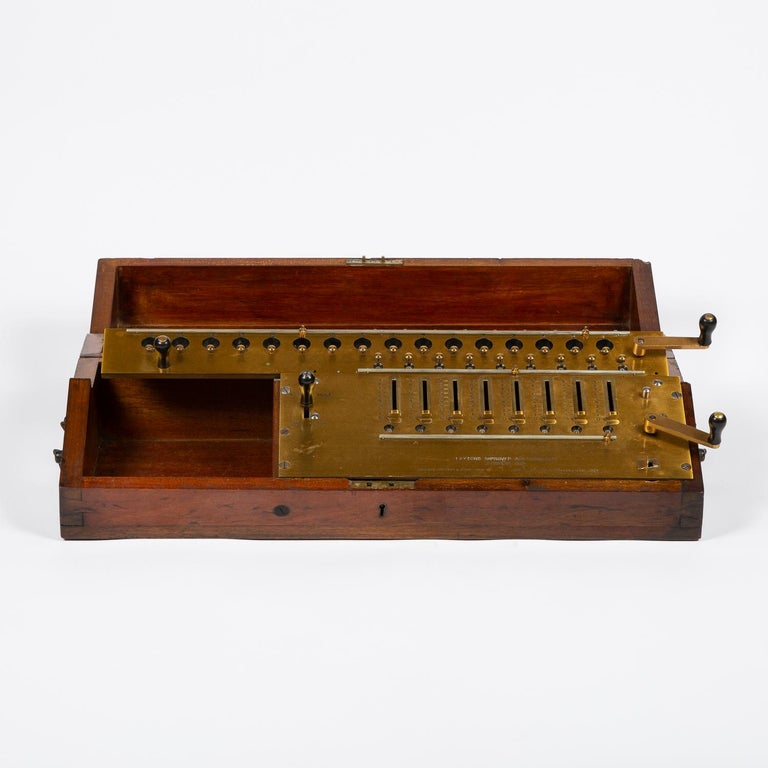A Layton's improved arithmometer by C & E Layton of London, in mahogany case, dated 1912.   The Arithmometer or Arithmomètre was the first digital mechanical calculator strong enough and reliable enough to be used daily in an office environment.