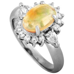 LB Exclusive Platinum 0.54 Carat Round and Pear Diamond and Opal Ring