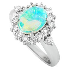 LB Exclusive Platinum 0.57 Carat Diamond and Opal Oval Ring