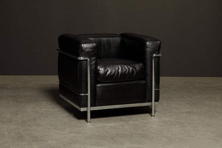 This incredibly comfortable Le Corbusier for Cassina (authentic signed) 'LC2' club chair in gorgeous thick Italian black leather is in excellent vintage condition and ready to be immediately placed in your home or office.   *Note, you will see a