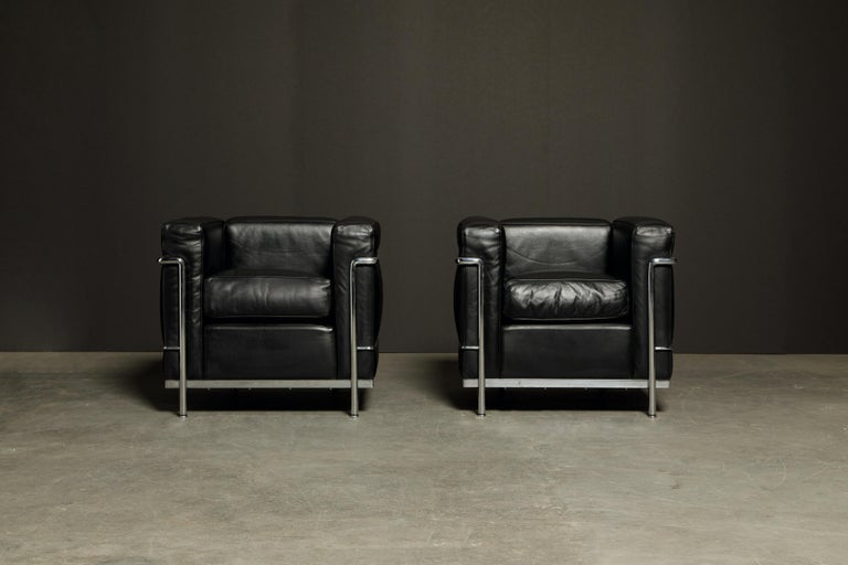This incredibly comfortable pair of Le Corbusier for Cassina (authentic signed) LC2 Club Chairs in gorgeous thick Italian black leather, priced in this listing individually.