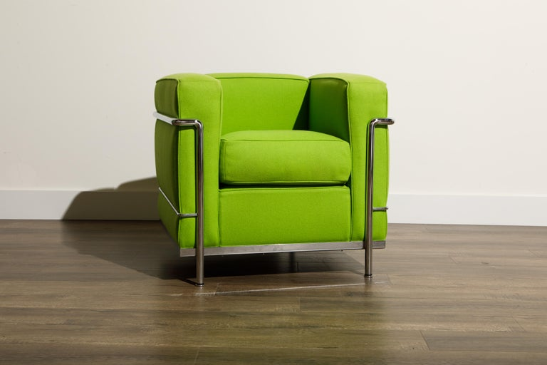 An incredibly comfortable and signed (authentic) 'LC2' Club Chair designed in 1928 by Le Corbusier, Pierre Jeanneret and Charlotte Perriand for Cassina in an interesting day-glo green color fabric. Produced by Cassina from 1965 to today, this