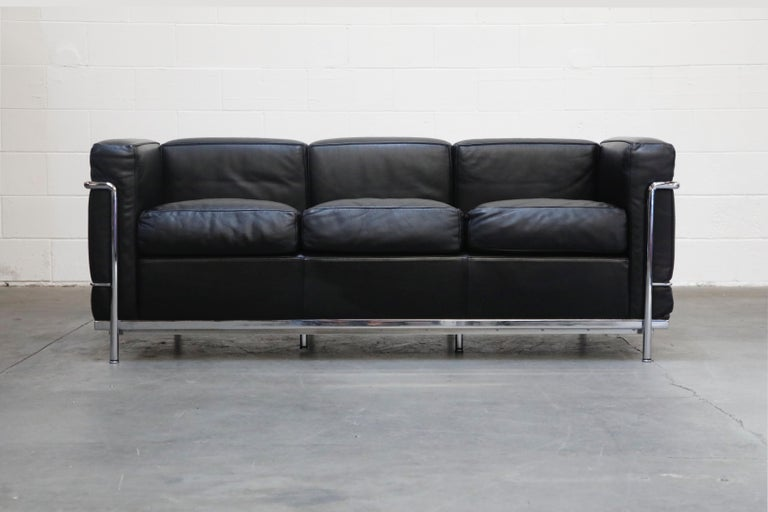 This incredibly comfortable Le Corbusier for Cassina (authentic signed) LC2 three-seat sofa in gorgeous thick Italian black leather and tubular chrome frame. We also have the matching pair of club chairs in another listing, contact us or see our