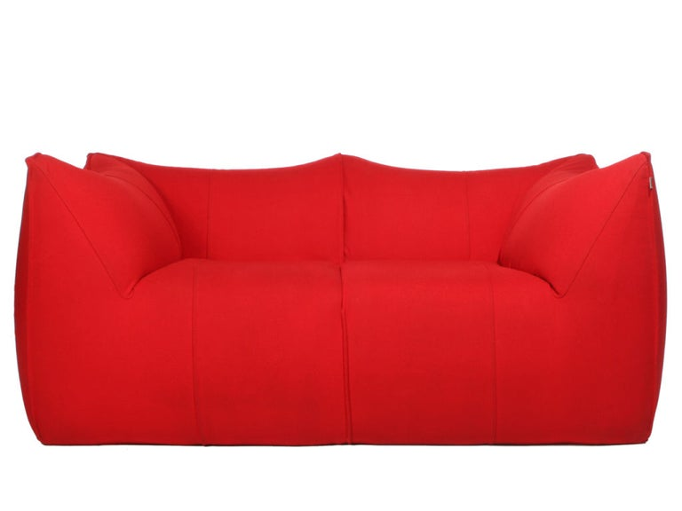 A Le Bambole settee by Mario Bellini with peaked corners, retaining the original red wool fabric. 