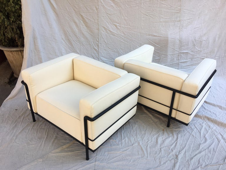 Le Corbusier LC-3 lounge chairs for Cassina in an off white canvas. Newly recovered cushions, with the original Cassina bottom ticking. Blacks frames show very minimal wear. Nice comfy chair perfect for that beach house!  Each Chair Frame is marked
