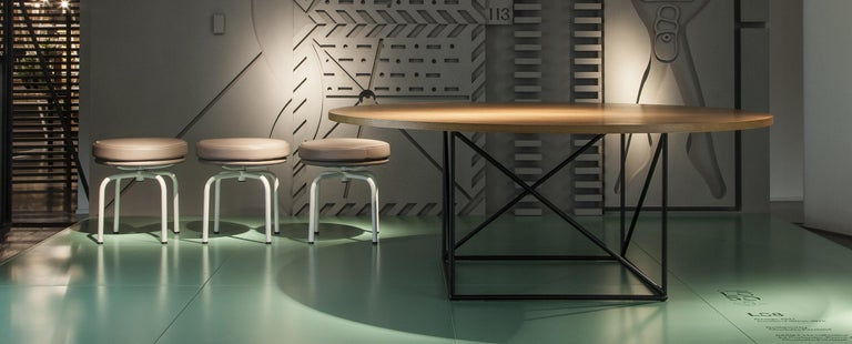 Table designed by Le Corbusier in 1958. Relaunched in 2010. Manufactured by Cassina in Italy.  Organic and yet rational, this table was designed by Le Corbusier in 1958. Its distinctive construction derives from two geometric figures: the circle,