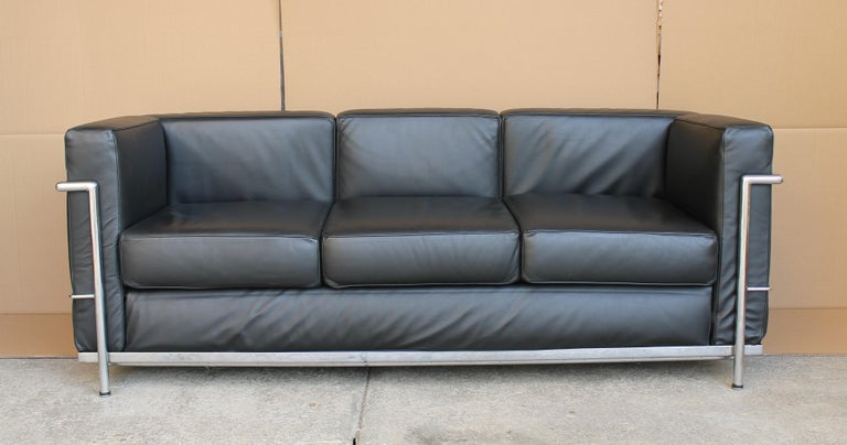 Le Corbusier LC2 black leather three-seat sofa for Alivar.  The sofa is in very good conditions.  Licensed edition Le Corbusier sofa by Alivar. Alivar was the first licensed manufacturer of Le Corbusier designs furniture not Cassina.