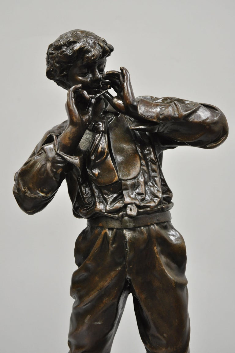 Le Fumeur French Spelter statue sculpture of young man smoking by Charles Masse. Item features brass plaque reads