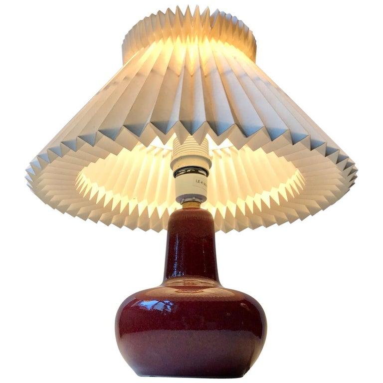 Le Klint Ceramic Table Lamp with Oxblood Glaze by Ole Bøgild, 1970s For Sale