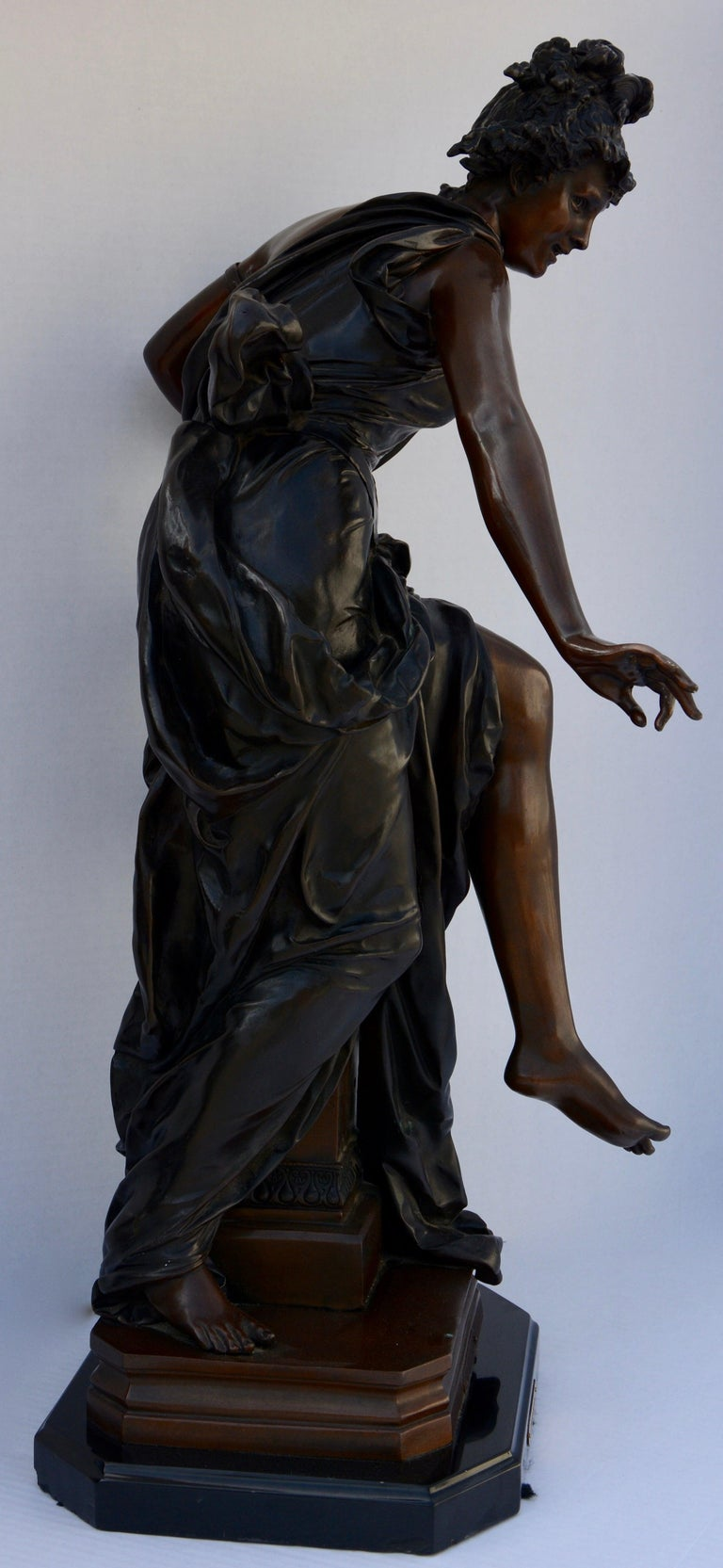 This is a late 19th century Le Melodie bronze sculpture by Albert-Ernest Carrier-Belleuse. It features a lady with her harp and lovely attire. The piece is marked.