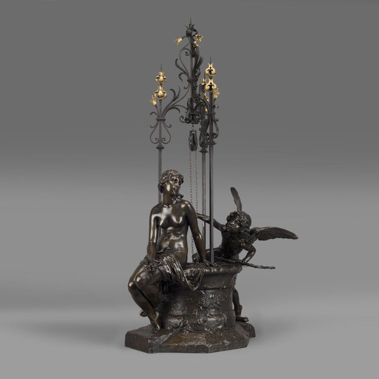 'Le Puits Qui Parle' (The Speaking Well) - An Important Exhibition Bronze Group, by Paul Eugène Mengin.  Signed to the cast 'P MENGIN', and inscribed 'Susse Fres Edts, Paris', and with foundry mark 'SUSSE FRERES EDITEURS/ PARIS'.   First