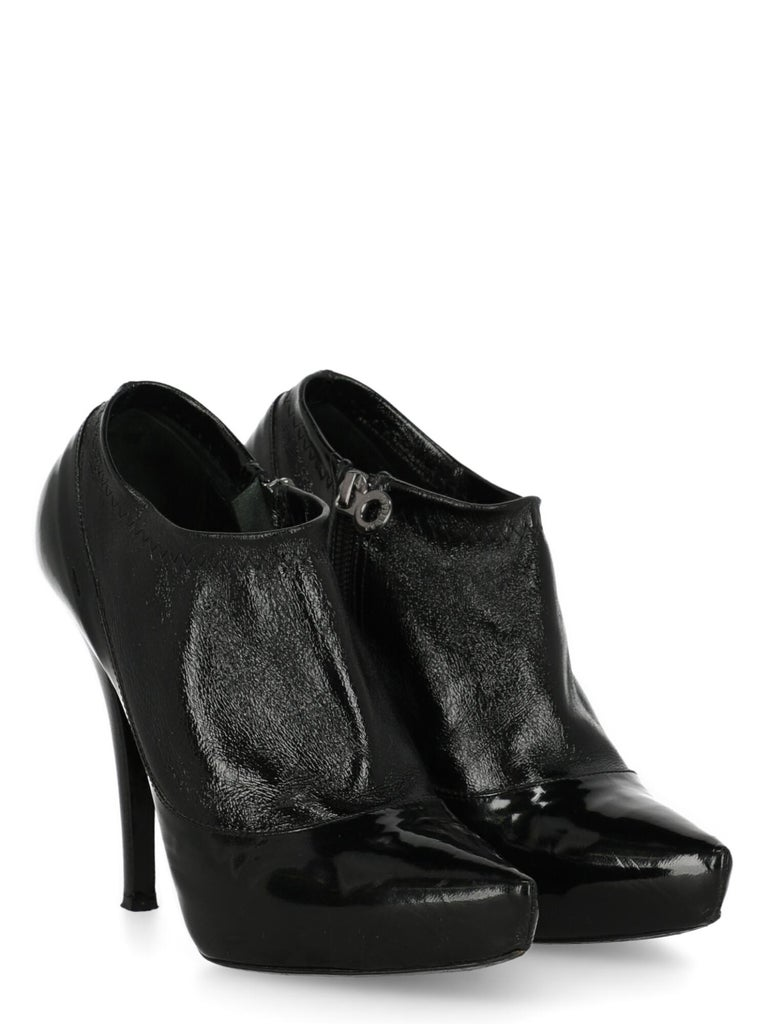 Product Description: Ankle boots, leather, solid color, side fastening, silver-tone hardware, pointed toe, branded insole, cone heel, high heel  Includes: N/A  Product Condition: Very Good Heel: negligible marks. Sole: visible signs of use. Upper: